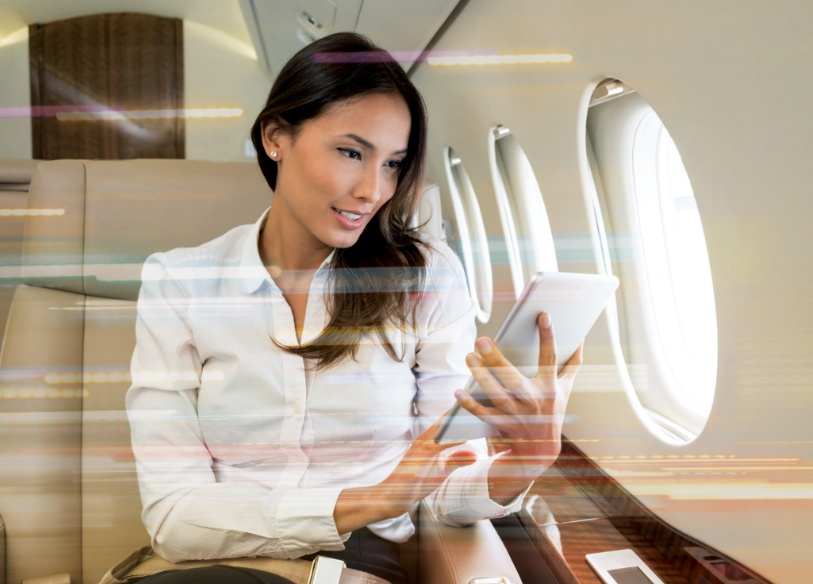 woman sitting on private jet
